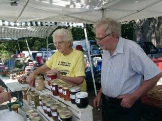 Gail and Clyde Martin with their farmer's market booth in El Dorado Kansas.