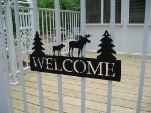 A welcome sign or door mat sets the tone for the visit.
