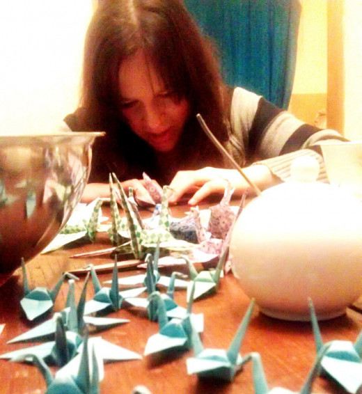 One of my bridesmaids working on paper cranes at one of our crafternoons