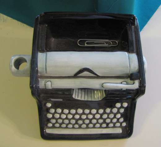 tiny typewriter glass paperclip holder