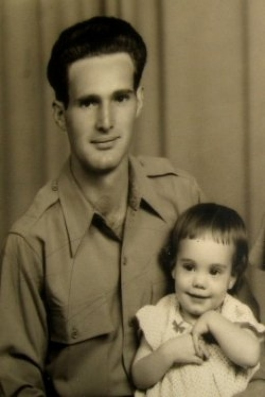 My Dad, Clyde Martin, and his first daughter. Eventually he had six children.