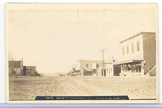 store on right side is Ulrich Bros Grocery & Dry Goods..no longer standing..Jack Williams had dance club upstairs in the 40s..Doc Rinker had dental office..(lila fry)