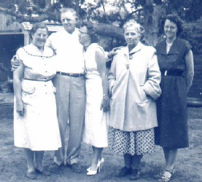 Clarence and Ruth McGhee (in coat) with 3 daughtersL to R: Melba, Carol, Gail