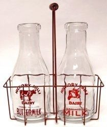Milk bottles and a carrier from the days of house-to-house delivery.