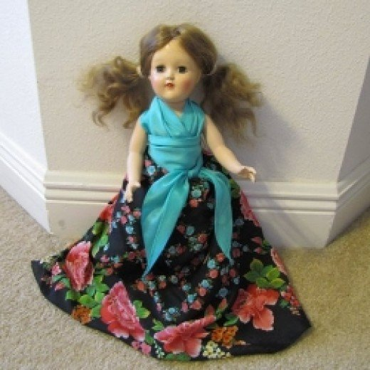The doll's skirt and top and sash are all made from scarves.