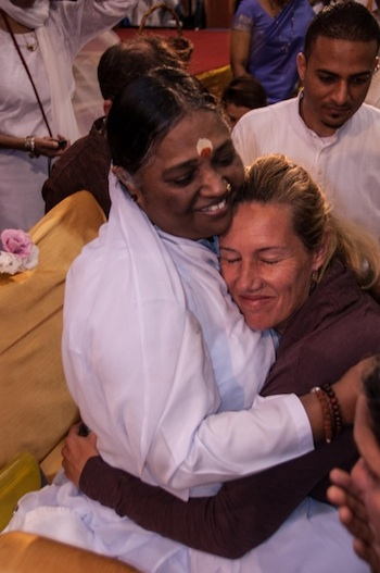Amma (Mata Amritnandamayi) hugs everyone and showers unconditional love. Can we?