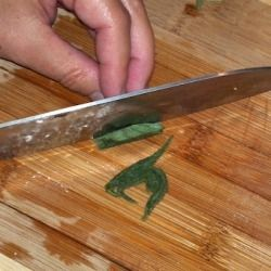 Roll the herbs and slice crosswise.