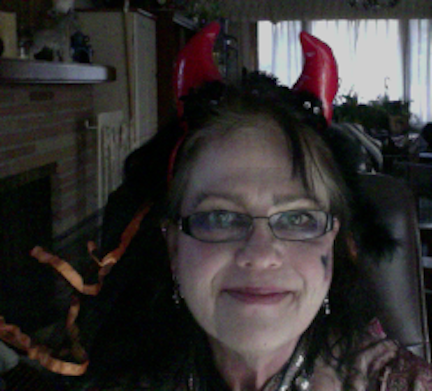 Mom always gets into the Halloween spirit and dresses up with the furkids!