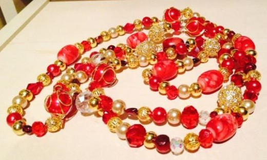 Red/Gold theme featuring Garnets, Glass Pearls, Swarovski Crystals, Art Glass and gold plated beads and findings.