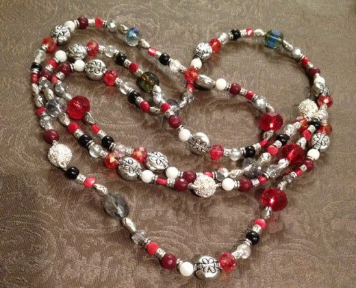 What's black, white and red all over? This necklace! Onyx, garnet, ruby, Pearls, Moonstone and more!