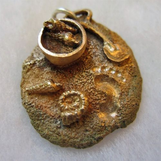 A bronze beach scene charm I sculpted from BRONZclay metal clay and fired in a kiln.