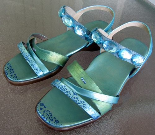 A pair of old, boring, beige leather sandals transformed into fun and fashionable footwear with some acrylic paint and faux jewels. Created and photographed by Margaret Schindel, all rights reserved.