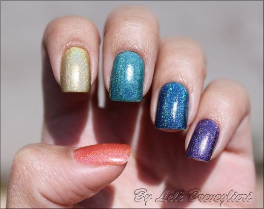 A striking manicure in a rainbow of nail polish colors.