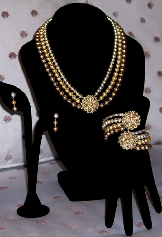 My vintage-inspired, one-of-a-kind bridal jewelry set, custom commission. Necklace, earrings and bracelet with tonal Swarovski crystal-based pearls, freshwater pearls, and vintage brass filigrees embroidered by hand with pearls using very fine wire.