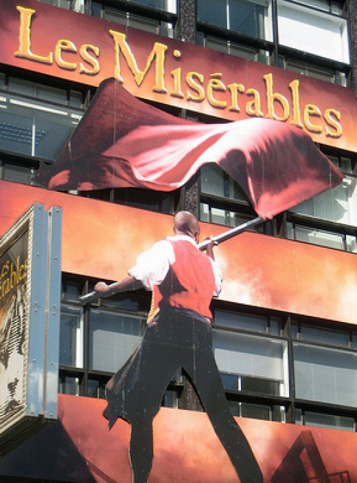 "Large display of ""Les Miserables"" on building front"