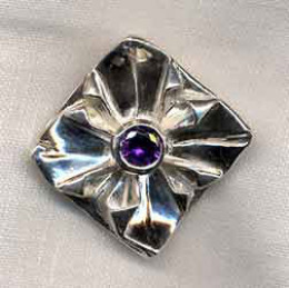 Fine silver metal clay origami brooch with an amethyst CZ set in a silver clay coil setting.