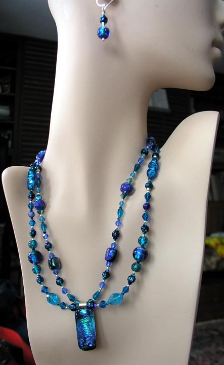 "My ""Pacific Blues"" necklace and earrings set features a dichroic glass pendant and two strands of vintage and contemporary glass beads, some dichroic."
