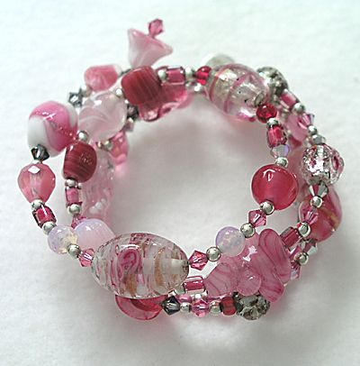 One-of-a-kind coil bracelet with vintage and contemporary  glass beads and crystals.