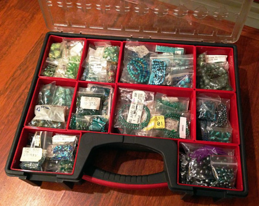 One of the parts storage cases I use for storing my beads and jewelry supplies, organized by color family