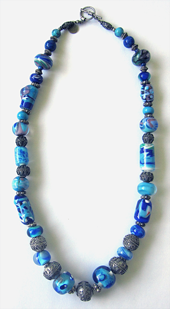 The beaded necklace I created to display the first lampwork glass beads my husband and I ever made during our honeymoon in Italy.