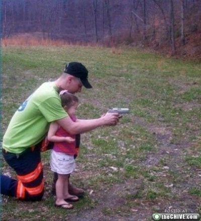 Gun safety?!! If that gun kicks when fired, it'll hit that little girl right in the face!