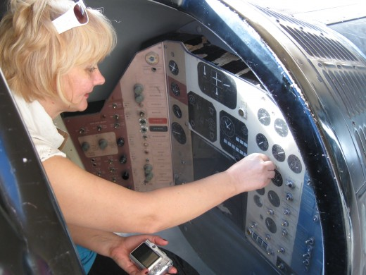 My wife at controls of Mercury Space Capsule
