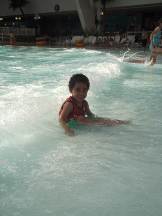 My son enjoying the wave pool at West Edmonton Mall's World Waterpark...