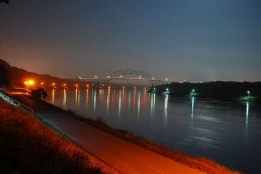 The Cape Cod Canal and Sagamore Bridge at night.