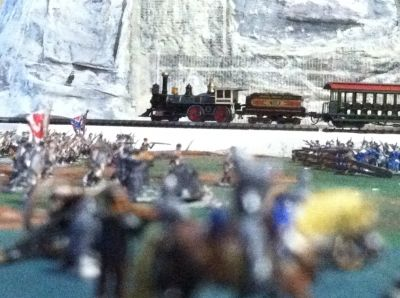 My N Scale Train Chugging By Embattled Troops