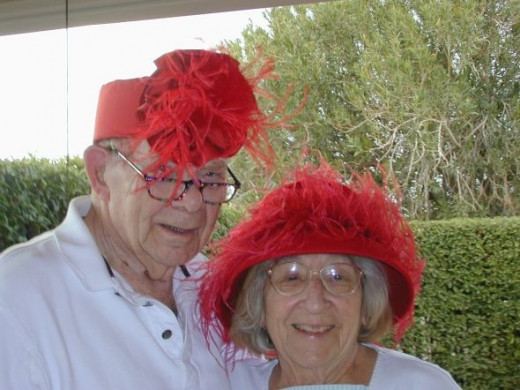 94 year old man and woman in hats