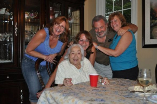 Another dinner group. Andi, Howie, Bobbi work to keep both Mom and me propped up with laughter and general merriment.