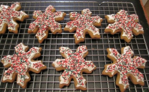 Gingerbread Snowflake cookies with icing and sprinkles