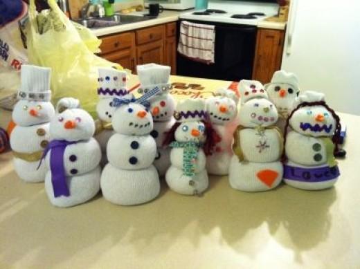 A whole village of sock snowmen - Great stocking stuffers (ha ha)