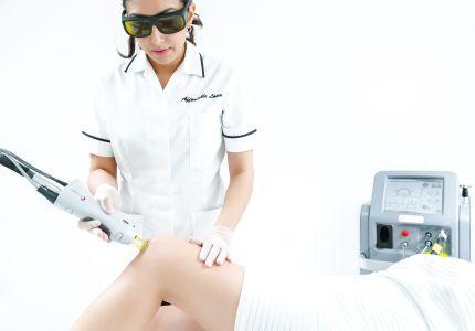 Using laser to remove leg hair.
