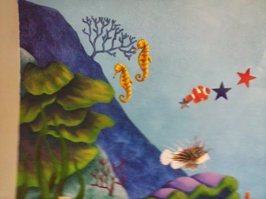 Painting an underwater wall mural for El paradiso wall mural
