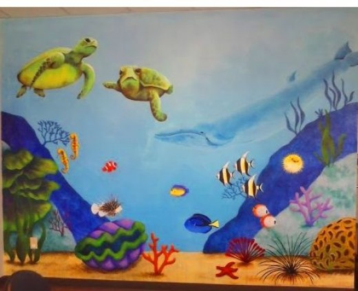 Painting an underwater wall mural for Dolphin paradise wall mural