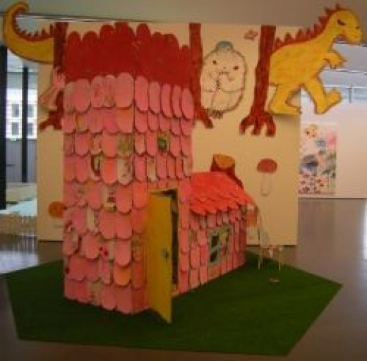 A cardboard house by artist Ayako Rokkaku - photo by author, donated to Public Domain