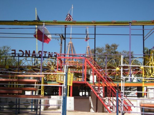 The Orange Show, scrap metal railings, structure, and bleachers - plus tractor seats for some of the audience.