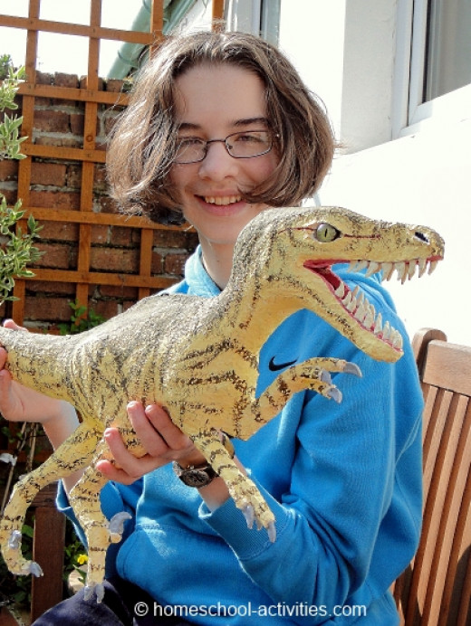 My daughter with her velociraptor dinosaur