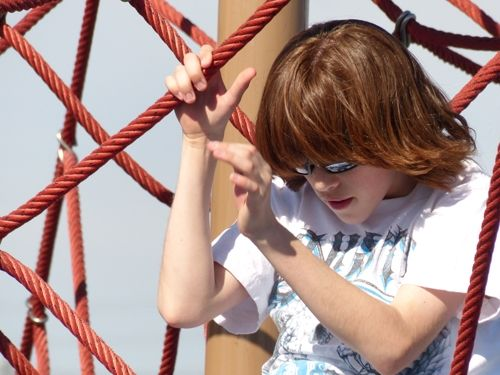 Here's a close-up photo of my son on a playground structure. This photo was zoomed all the way to 24x (600mm equivalent).