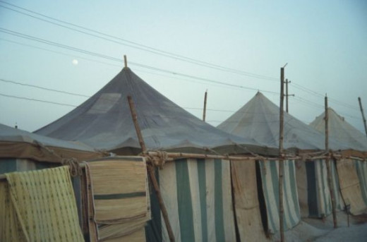A full moon over one of the tent camps.