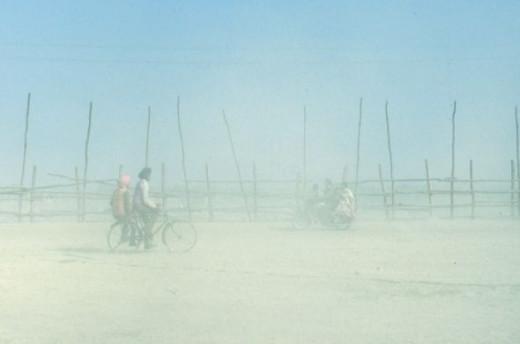 Riding bikes through the dusty mela grounds