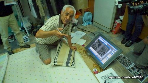 Veteran Korean comic creator Tae San Jang showing us his artworks on a Cintiq.