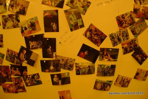 Photo collage at the closing ceremony entrance hall.