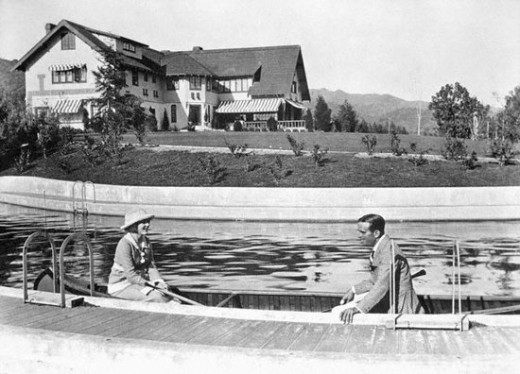 Mary Pickford and Douglas Fairbanks canoe in their Pickfair swimming pool. Photo credit Wikimedia Commons.