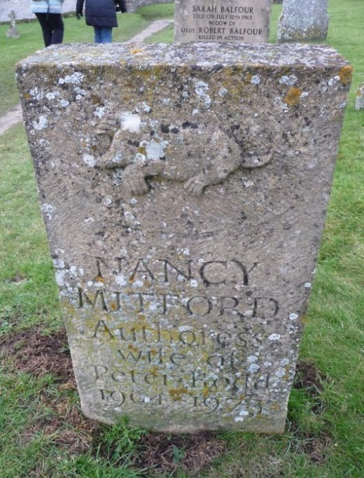 Nancy Mitford Tomb with Mole Emblem in Swinbrook church graveyard overlooking the Windrush