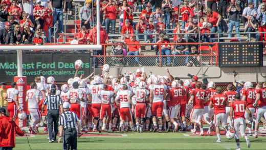 Football players lift Jack Hoffman on their shoulders after he makes a touchdown during the spring game.