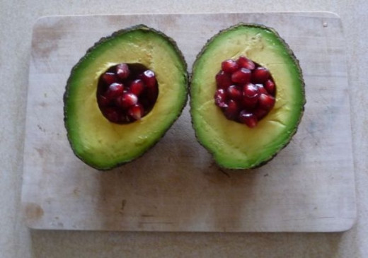Avocado Halves filled with Pomegranate berries