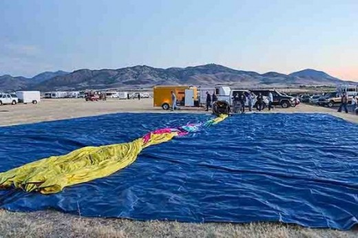 The balloon is stretched out on a tarp in preparation for inflation