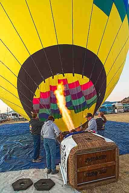 The ballon begins to lift as the burner begins to fill it with hot air
